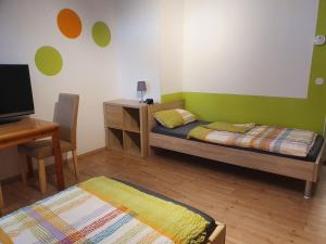 Ein Bett oder Betten in einem Zimmer der Unterkunft Monteurwohnung Ferienwohnung Landshut