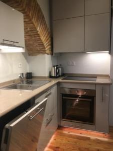 A kitchen or kitchenette at Casa da Alcacova