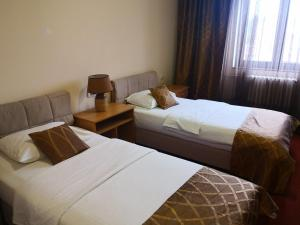 A bed or beds in a room at Hotel N