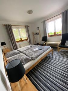 A bed or beds in a room at Pension Ferda