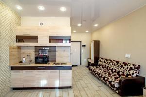 A kitchen or kitchenette at Kozette Apartaments