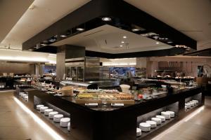 エバーグリーン プラザ ホテル タイナンにあるレストランまたは飲食店