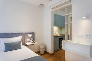 Uma cama ou camas num quarto em Hotel das Salinas