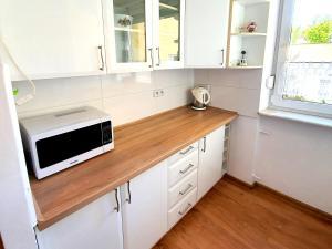 Kuchnia lub aneks kuchenny w obiekcie Apartament przy Plaży