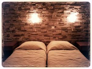 Ένα ή περισσότερα κρεβάτια σε δωμάτιο στο Ξενοδοχείο Κωστής