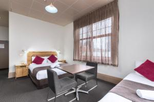 A bed or beds in a room at Adelaide Paringa