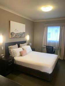 A bed or beds in a room at Best Western Blackbutt Inn