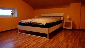 A bed or beds in a room at Holiday House Koceri