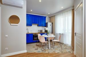A kitchen or kitchenette at Apartments Minsk2Go