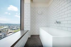 A bathroom at amba Taipei Songshan