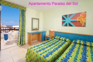 Een bed of bedden in een kamer bij Paraiso del Sol
