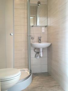 Łazienka w obiekcie Pokoje Gościnne Akwatel