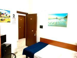 Lova arba lovos apgyvendinimo įstaigoje Hotel Alessander