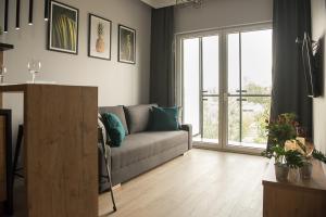 Posezení v ubytování Wola Loft Apartment