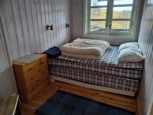 Ein Bett oder Betten in einem Zimmer der Unterkunft Sinnes Fjellstue Apartment 1F
