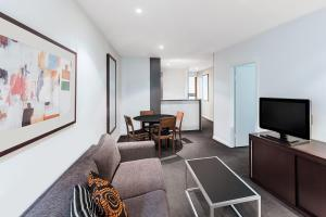 A television and/or entertainment centre at Adina Apartment Hotel Sydney Central