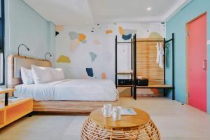 A bed or beds in a room at Cara Cara Inn
