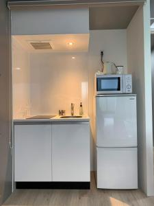 A kitchen or kitchenette at イートス恵比寿