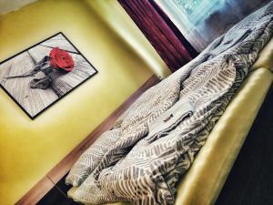 Postel nebo postele na pokoji v ubytování Hotel Český Ráj