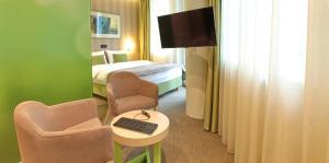 TV i/ili multimedijalni sistem u objektu Hotel Argo
