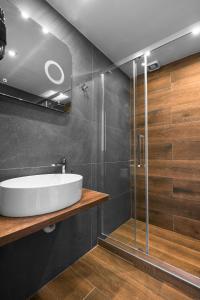 Um banheiro em Ultima Suites, Nilie Hospitality MGMT