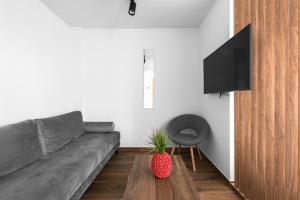 Uma área de estar em Ultima Suites, Nilie Hospitality MGMT