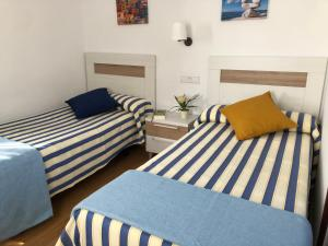 A bed or beds in a room at HOTEL CARAVIA