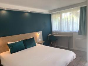 Un ou plusieurs lits dans un hébergement de l'établissement Kyriad Châteauroux - Saint-Maur