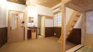 A bunk bed or bunk beds in a room at Poly Hostel 2 Namba
