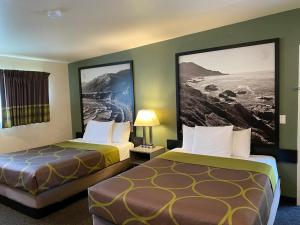 A bed or beds in a room at Super 8 by Wyndham Monterey