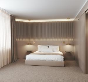 A bed or beds in a room at Carlemany Girona