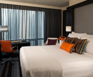 A bed or beds in a room at Courtyard by Marriott New York Manhattan/Central Park