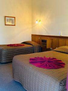 A bed or beds in a room at County Lodge Motor Inn