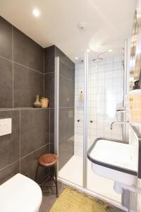 Ein Badezimmer in der Unterkunft Hotel Dwars