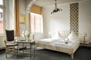 A bed or beds in a room at Haus Wullfcrona