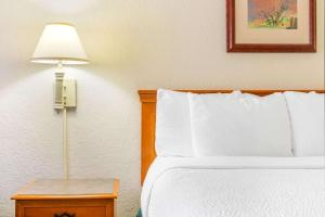 A bed or beds in a room at La Quinta Inn by Wyndham Eagle Pass