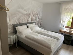 A bed or beds in a room at Hotel-Restaurant Sebastianushof