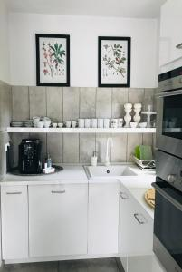 A kitchen or kitchenette at Pastel Guesthouse