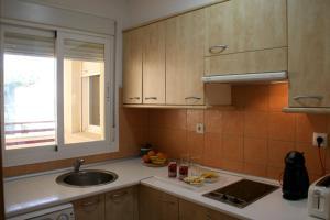 Una cocina o zona de cocina en Apartamentos Océano Azul Caños de Meca