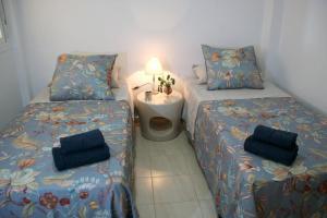 Cama o camas de una habitación en Apartamentos Océano Azul Caños de Meca