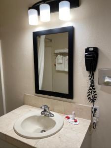 A bathroom at Super 8 by Wyndham Monterey