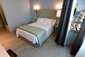 Cama o camas de una habitación en TC Hotel Doña Luisa