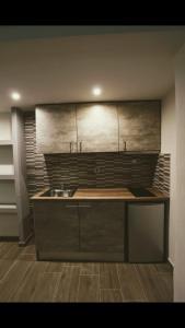 Η κουζίνα ή μικρή κουζίνα στο LDG Rooms
