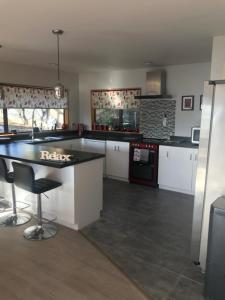 A kitchen or kitchenette at Akaroa harbour view