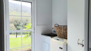 A kitchen or kitchenette at Cadair Cottages