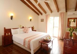 A bed or beds in a room at Mision Conca