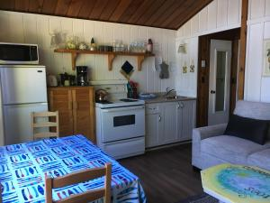 A kitchen or kitchenette at Maple Ridge Cottages