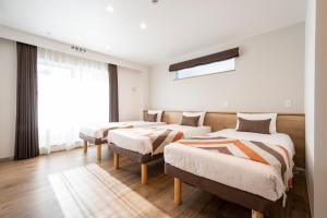 A bed or beds in a room at Eisei Stay