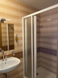 Ванная комната в Dzintars Hotel