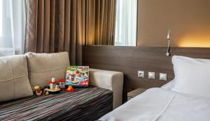 A bed or beds in a room at Expo Hotel